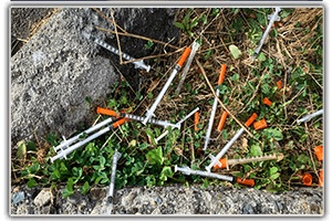 SPECIALTY SERVICES: Needles on ground from encampment. Encampment Clean-up