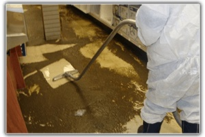 CLEANING & MITIGATION: Technician cleaning up sewage